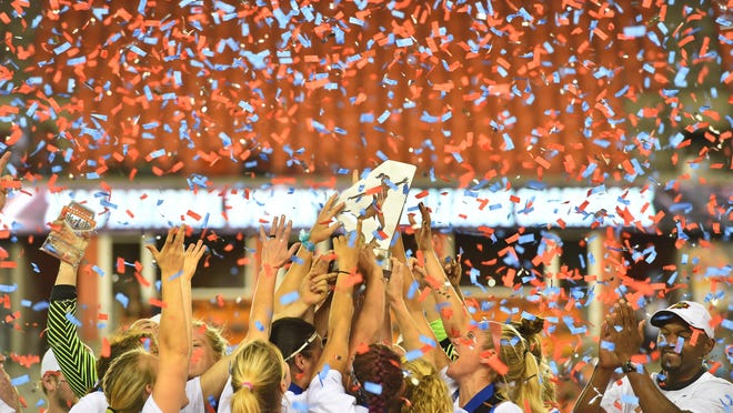 Players on the Western New York Flash celebrate winning the NWSL championship on Sunday.