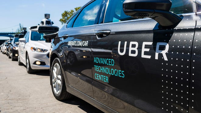 AFP_N04HC.jpg (FILES) This file photo taken on September 13, 2016 shows pilot models of the Uber self-driving car at the Uber Advanced Technologies Center in Pittsburgh, Pennsylvania. Uber has grounded its fleet of self-driving cars pending an investigation into the crash of an Uber autonomous vehicle in Arizona, a spokesperson for the car-hailing service said on March26, 2017. No one was seriously injured in the accident which occurred on March 24 in Tempe, Arizona, while the vehicle -- a Volvo SUV -- was in self-driving mode, the company said. / AFP PHOTO / Angelo MerendinoANGELO MERENDINO/AFP/Getty Images