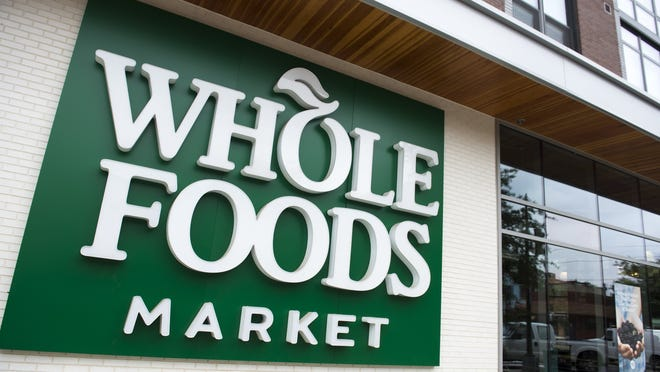 A Whole Foods Market sign is seen in Washington, DC, June 16, 2017, following the announcement that Amazon would purchase the supermarket chain for $13.7 billion. (Photo credit should read SAUL LOEB/AFP/Getty Images)
