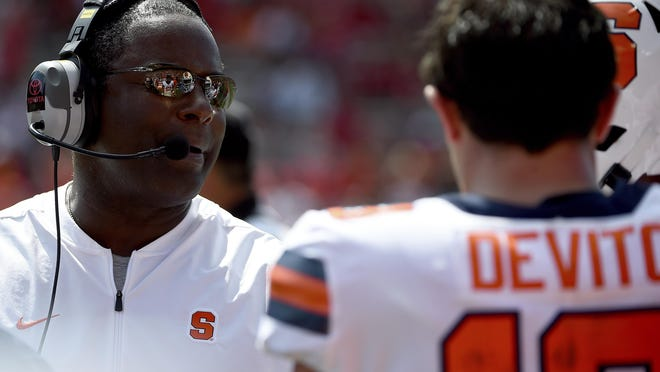 Syracuse Orange head coach Dino Babers speaks with quarterback Tommy DeVito (13) during the second half of an NCAA college football game against the Maryland Terrapins, Sept. 7, 2019, in College Park, Md.