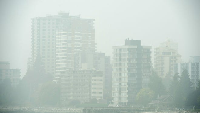 Buildings in West Vancouver, British Columbia, are obscured due to the heavy smoke in the air Monday.