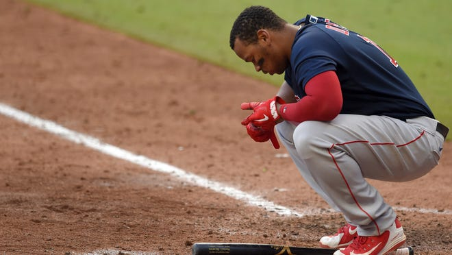 Boston Red Sox third baseman Rafael Devers (11) reacts after striking out against the Atlanta Braves during the ninth inning at Truist Park on Sept. 27, 2020.