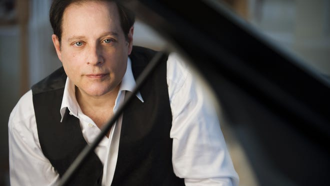 Pianist Michael Lewin won a Grammy in 2014 for the crossover recording 'Winds of Samsara.'