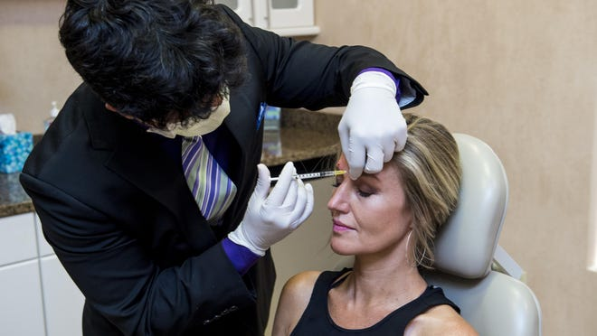 Dr. Marc Polacco injects Xeomin into the face of Mel Overstreet at The Georgia Center for Facial Plastic Surgery in Evans, Ga., Tuesday morning, August 4, 2020.