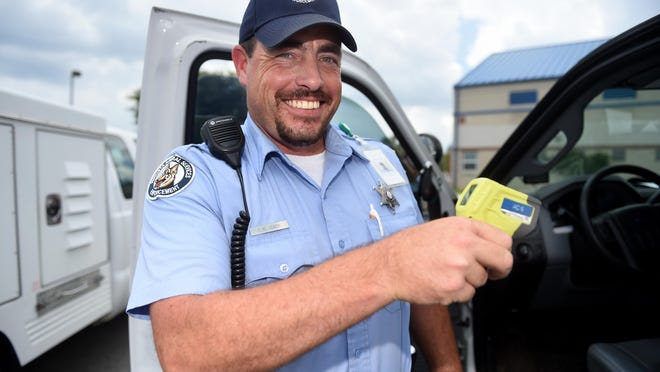In this 2018 file photo, then animal control officer Charles Case demonstrates an infrared thermometer. Case was shot and killed Thursday. Suspect Smitty Oliver Melton, 65, was arrested in Aiken County Thursday.