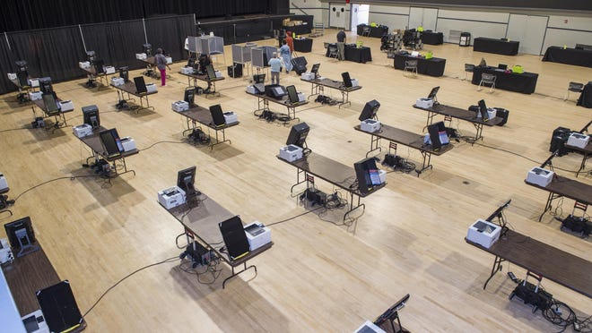 Workers set up voting machines at the Bell Auditorium in preparation for advance voting set to begin Monday.  Photographed at the Bell Auditorium Thursday afternoon October 8, 2020 in Augusta, Ga.