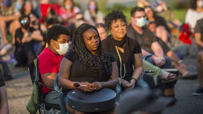 Peoria Drum Circle members and others in the more than 200 people gathered at Sous Chef in Peoria Wednesday, June 3, 2020 listen to a speaker during a vigil in honor of George Floyd.