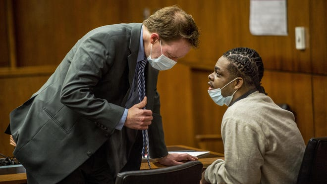Jermontay Brock, right, talks to his attorney, Peoria County Public Defender's Office First Assistant Kevin Lowe, before the start Tuesday, July 21, 2020 of Brock's trial in the 2018 shooting deaths of Anthony Polnitz, 22, and Nasjay Murry, 18, at a party in a house in the 1800 block of West Bradley Avenue. Brock, 18, is charged with first-degree murder and aggravated battery in connection with the fatal shootings of Polnitz and Murry.