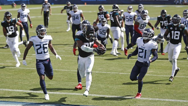 Jacksonville Jaguars running back James Robinson (30), a former Lutheran star from Rockford, scores his first NFL touchdown on a 17-yard run against the Tennessee Titans on Sunday in Nashville, Tenn.