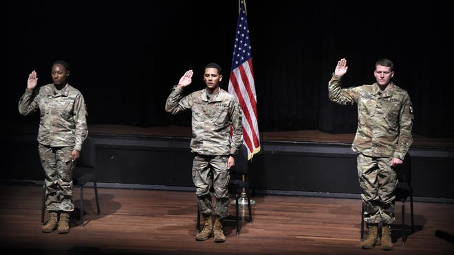 Cadets, from left, La'Chelseia Allen, Jonah Cali and James Dresser, take the oath during the ROTC commissioning ceremony at Augusta University's Maxwell Theatre in Augusta, Ga., Friday morning June 12, 2020.