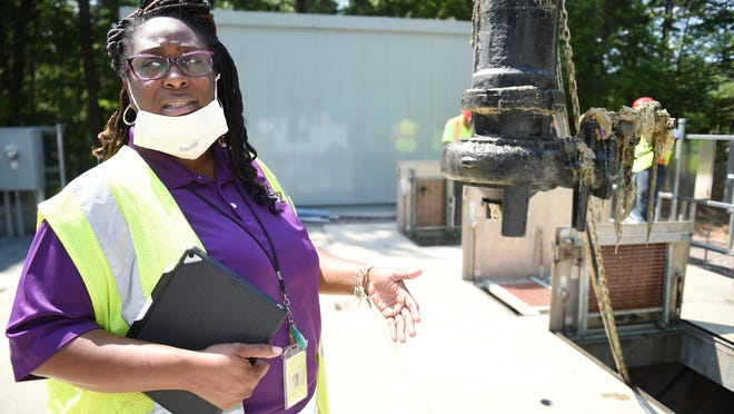 Augusta Utilities public information officer Leadra Collins, with a clogged pump at a sewage pumping station near Fort Gordon Monday morning June 22, 2020. Augusta Utilities is having problems with people flushing wipes, masks, gloves and other items down the toilet where they clog up pumps like this one.