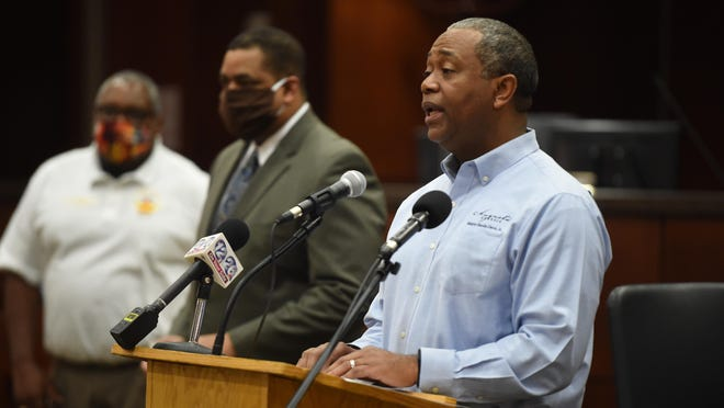 FILE - Augusta Mayor Hardie Davis, right, holds a COVID-19 briefing accompanied by, from left, Augusta Fire Chief Chris James and Richmond County Sheriff Richard Roundtree in the Commission chambers at the Municipal Building in Augusta, Ga. Friday morning May 1, 2020.