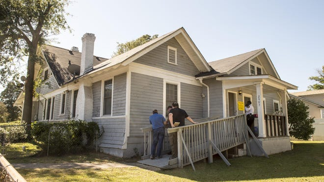 Investigators gather outside the First Love Personal Care Home in Augusta, Ga., Monday afternoon October 19, 2020.