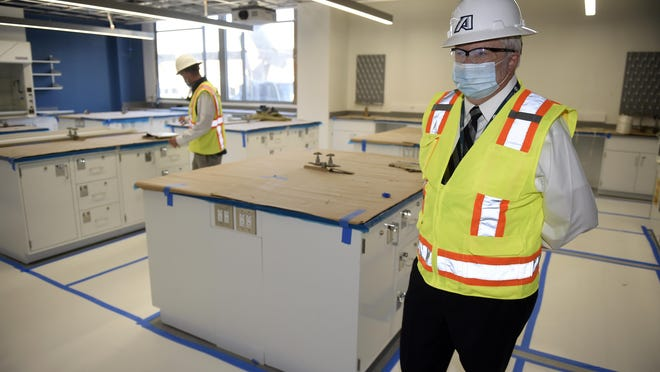 Augusta University President Dr. Brooks Keel, right, tours one of the new labs being built in the new College of Science and Math Building at the school's medical campus in Augusta Monday morning November 16, 2020.