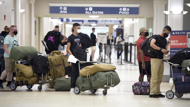People wait in the line to drop off their luggage and get their tickets at Augusta Regional Airport in Augusta, Ga., Tuesday afternoon September 1, 2020.  The airport is getting more than $8.3 million in federal funds for new equipment and infrastructure improvements.