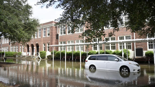 A flooded van sits outside CT Walker Magnet School as the remnants of Hurricane Sally passed over Augusta, Ga., Thursday morning Sept. 17, 2020