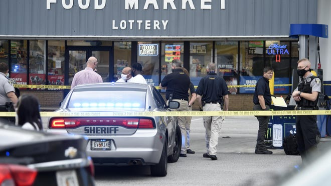Richmond County Sheriff's investigators gather at the Shopper's Stop convenience store on Olive Road after a shooting Tuesday afternoon Sept. 29, 2020 in Augusta, Ga.