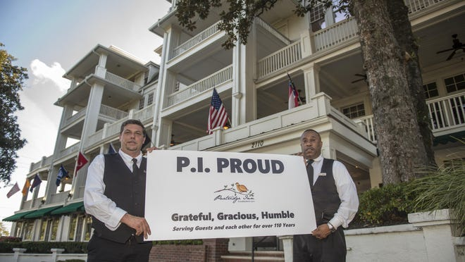 Partridge Inn employees Michael Marcelain, left, and James Searcy stand outside the historic Partridge Inn in Augusta, Ga., Thursday afternoon November 5, 2020.