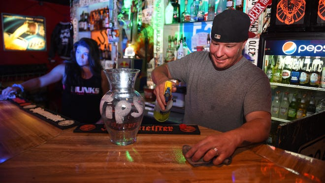 Chad Mac, right, and his wife, Snooky Mac, clean the bar at their business, Kickers, on Peach Orchard Road in Augusta, Ga., Thursday afternoon April 23, 2020.