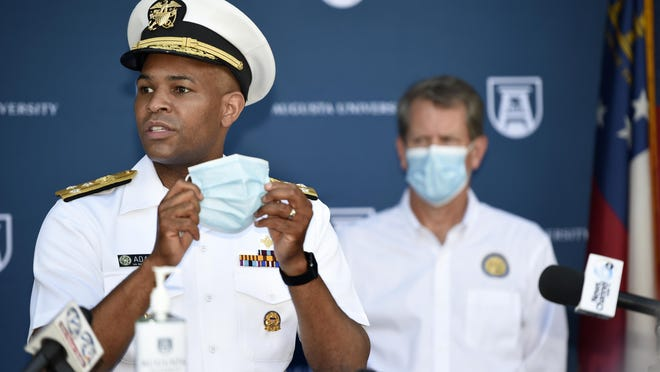 """U.S. Surgeon General Vice Admiral Jerome M. Adams talks about the importance of wearing masks at the Georgia Cancer Center in Augusta, Ga., Wednesday morning July 2, 2020, as part of Gov. Brian Kemp\'s """"Wear a Mask"""" Fly-Around Tour to promote the wearing of masks as COVID numbers rise in Georgia."""