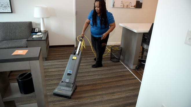 Housekeeping manager Tracy Thompkins cleans a room at the Hyatt House Hotel in Augusta, Ga., Monday afternoon March 23, 2020.