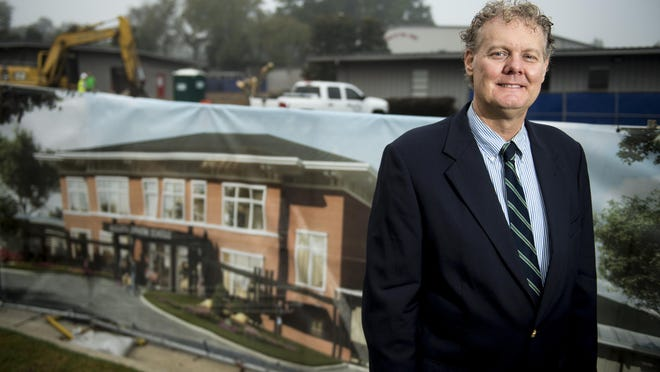 Augusta Christian Head of Schools Les Walden stands near an illustration of the new building as work to build it continues in the background Wednesday morning October 7, 2020 in Martinez, Ga.