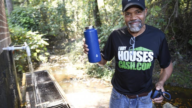 Bernard Barbour with a bottle of spring water he just filled at the Flowing Wells Spring in Augusta, Ga., Tuesday afternoon October 13, 2020