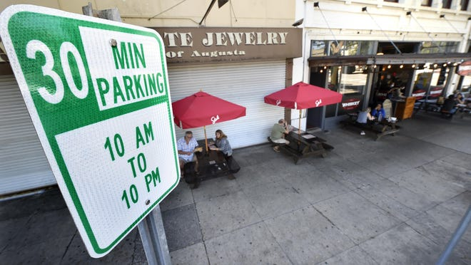 New 30-minute parking signs installed near restaurants downtown, such as this one near the Whiskey Bar Kitchen, are intended to help people pick up their to-go orders quickly.  Photographed in Augusta, Ga., Wednesday afternoon October 14, 2020
