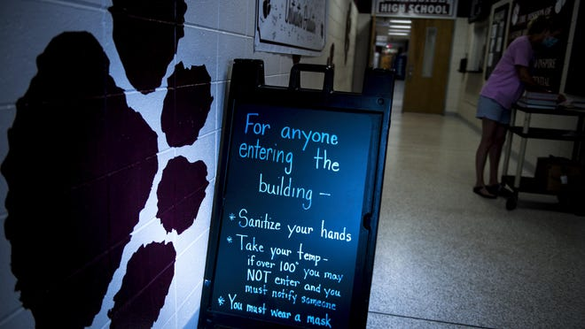 A sign at the front door spells out what is required for students coming into Lakeside High School in the age of COVID-19.