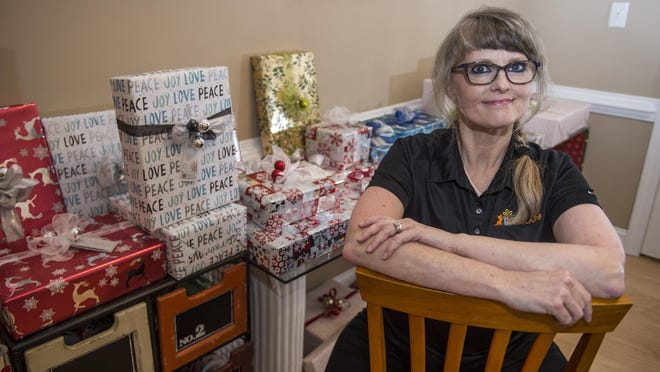 Angela Maskey with some of the gifts she's wrapped at her home in Evans, Ga., Wednesday evening November 24, 2020.