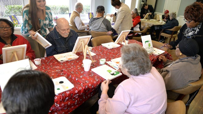 Staff at the Jud C. Hickey Center for Alzheimer's Care help members with a  painting activity. The nonprofit organization is among those that can benefit from donations as part of GivingTuesday and GAgives Day on Dec. 1.