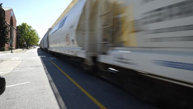 FILE- A freight train travels through downtown Augusta April 6, 2020.