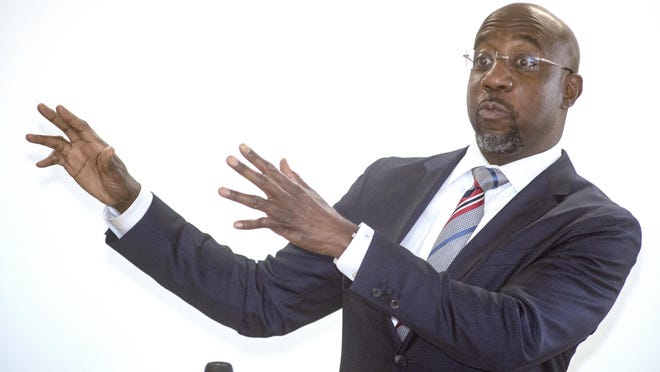 Democratic U.S. Senate candidate Raphael Warnock speaks during a campaign stop at Antioch Baptist Church in Augusta.