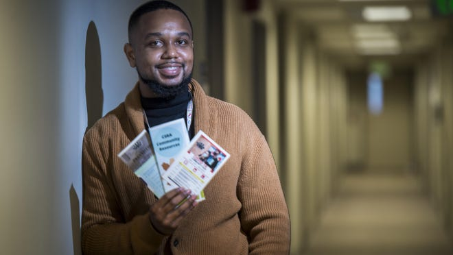 Dr. Justin X. Moore holds pamphlets he plans to distribute to help educate people about COVID-19 in Augusta, Ga., Tuesday morning December 1, 2020.