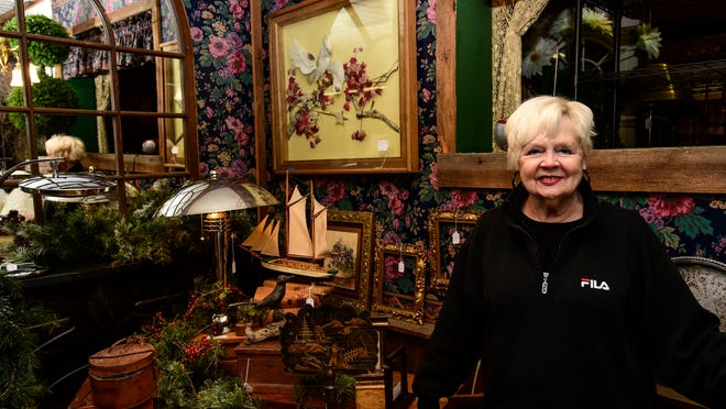 Joanne Scott, owner of Mad Hatter Antiques, stands in her shop located at 284 Clinton Street in Binghamton.