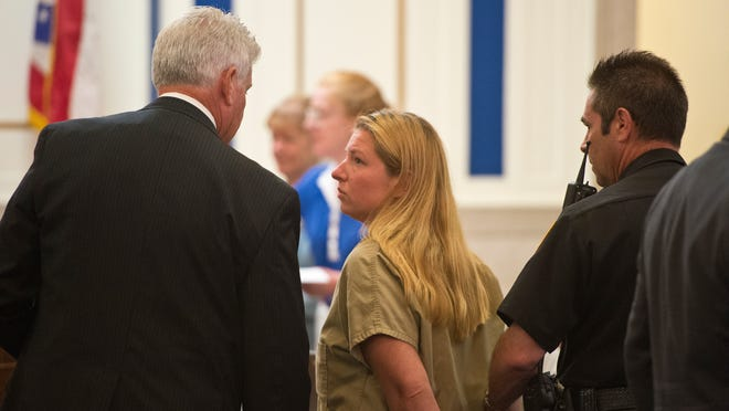 Julie Hautzenroeder is led out of the courtroom by an officer after her bail was set on July 31, 2013. Colerain High School teacher Julie Hautzenroeder, 36, was arrested by Hamilton County sheriff's deputies on July 30 for having sex with two students.  Adam Birkan/The Community Press Colerain High School teacher Julie Hautzenroeder is led out of the courtroom Wednesday by an officer. Hautzenroeder, 36, was arrested by Hamilton County sheriff's deputies Tuesday morning on charges of having sex with two students.  The Enquirer/Adam Birkan Julie Hautzenroeder is led out of the courtroom by an officer after her bail was set on July 31, 2013. Colerain High School teacher Julie Hautzenroeder, 36, was arrested by Hamilton County sheriff's deputies on Tuesday morning for having sex with 2 students. The Enquirer/Adam Birkan