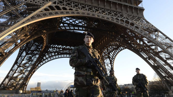 French soldiers patrol in front of the Eiffel Tower on Jan. 8 as Paris was placed under the highest-alert status. The attack on the satirical newspaper Charlie Hebdo a day earlier was the deadliest attack in France in four decades.