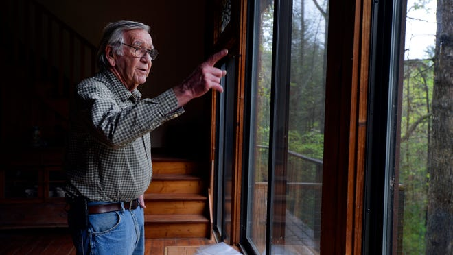 Thomas Don Lewis looks outside a wall of glass windows at his home in Cleveland, S.C., on Wednesday, April 15, 2015.