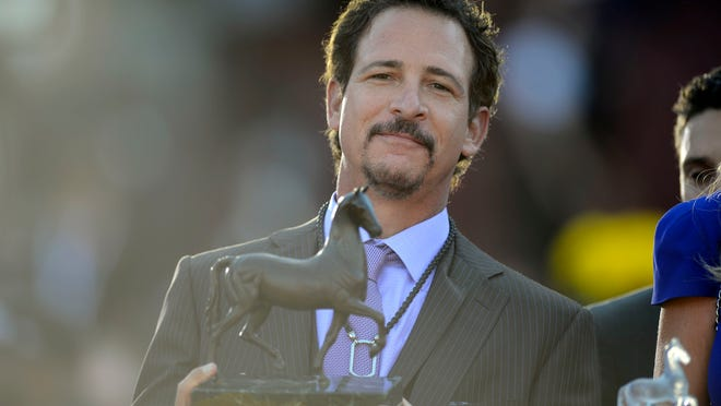 Jim Rome, owner of Mizdirection, celebrates a 2013 Breeders' Cup win.
