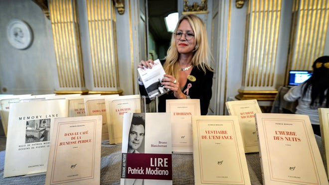 Books by French writer Patrick Modiano are displayed at the Royal Swedish Academy after he was declared the winner of the 2014 Nobel Prize in Literature on Thursday, Oct. 9, 2014 in Stockholm, Sweden. The prize was awarded 'for the art of memory with which he has evoked the most ungraspable human destinies and uncovered the life-world of the occupation,' the Swedish Academy said. (AP Photo/TT, Anders Wiklund) **  SWEDEN OUT  **