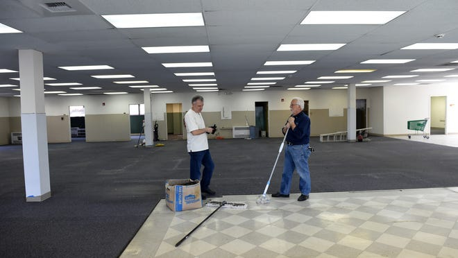 Ky Good, left, and Norm Smith clean up the new C4CUBE building in Midtown on Oct. 14, 2014. Reno-based incubator C4CUBE is moving into downtown's Midtown district along with about 11 startups affiliated with the organization.