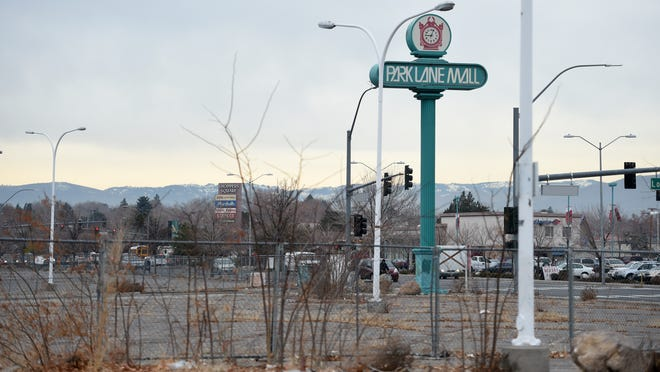 """This empty fenced-off lot was once Reno's Park Lane Mall. Now its an """"eyesore."""""""