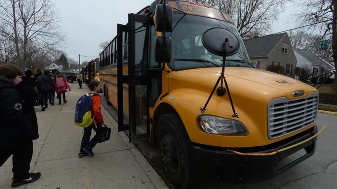 Students walk to school buses after being dismissed at Westview Elementary School in Richmond.