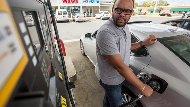 Terrell Scofield of Salisbury fuels up his car at WaWa in Salisbury, where regular unleaded was priced at $3.02 per gallon on Tuesday afternoon.