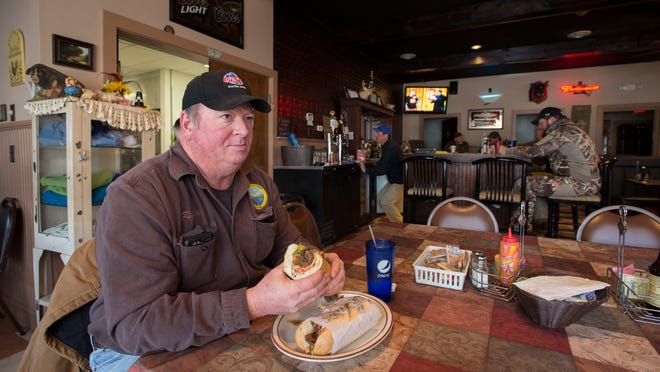 Rusty Eberspacher eats at Millie's Road House Bar & Grill twice a day, sometimes three. Owner Millie Cusick purchased the building, then a deli and convenience store, as a single mother in 1998. The place has now been completely rebuilt with an additional dining room. Millie's is the only restaurant and bar in Vienna.