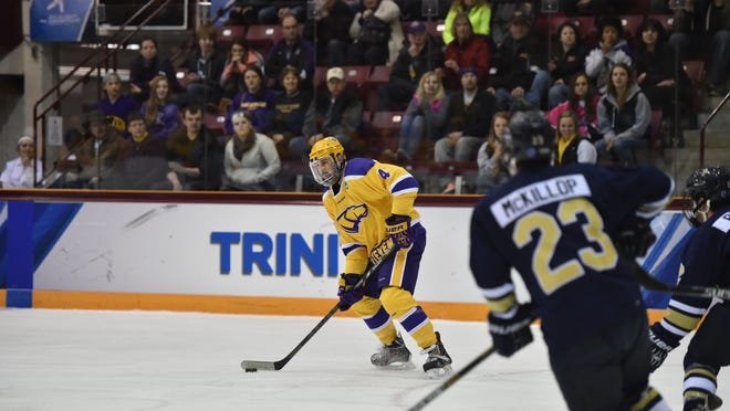 University of Wisconsin-Stevens Point defenseman Kyle Brodie looks to unleash a shotagainst Trinity College at Ridder Arena on Saturday night.