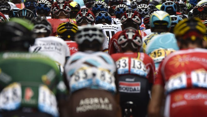 The pack rides during the 234.5 km seventh stage of the 101st edition of the Tour de France cycling race on July 11between Epernay and Nancy, northeastern France.