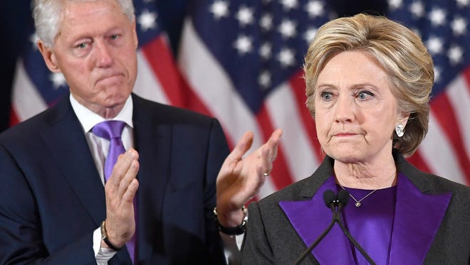 On Nov. 9, 2016, Democratic presidential candidate Hillary Clinton makes a concession speech in New York after being defeated by Donald Trump, as former President Bill Clinton looks on.