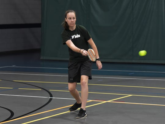 Paige Lane, director of Kids America, plays pickleball