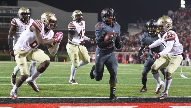 Michael Dyer runs in to the end zone for his second touchdown in the first half. Dyer was the Louisville lift  against Florida State. Oct. 30, 2014 By Matt Stone/The C-J